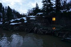 Small building across the creek from the pools