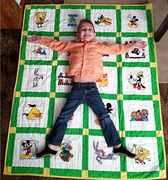 ^i^ Caleb with his quilt