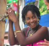 Beautiful smile from a young lady in Saint-Marc during a local soccer game