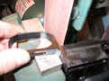 Using a block of steel under the trigger guard to keep it level. Contour the front face.