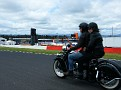 Two wheeled race fans heading down Mountain Straight
