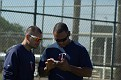Wilkin Ramirez (with cell phone) and a minor league coach